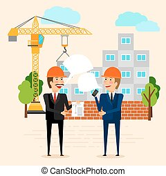 Builders discussing construction of house