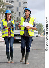 Construction people walking on building site