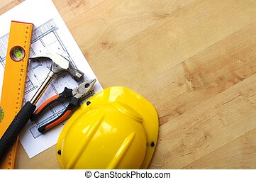 construction concept with hard hat working tools and...