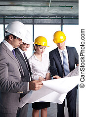 Construction - Business people at a construction site