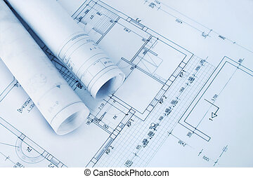 Construction plan blueprint rolls with drawings