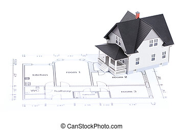 Construction plan with house architectural model on it