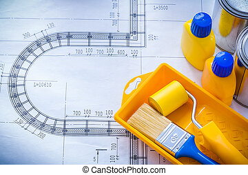 Construction plan with paint brush roller tray metal cans...