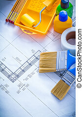 Construction plan with paint roller tray brushes plastic bottles
