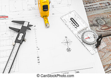 Construction plans  and drawing tools on blueprints .