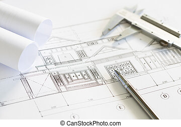 Construction plans and drawing tools on blueprints