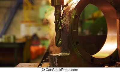 Construction plant. A machine drilling a hole in the iron...
