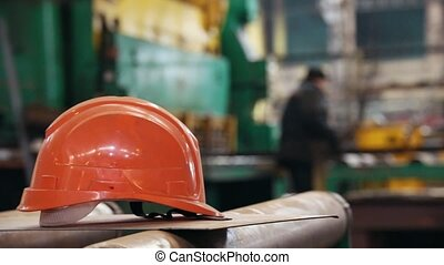 Construction plant. People working on a plant. A helmet on a...