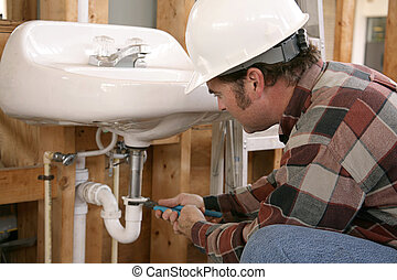 Construction Plumbing Work - A plumber in new home...