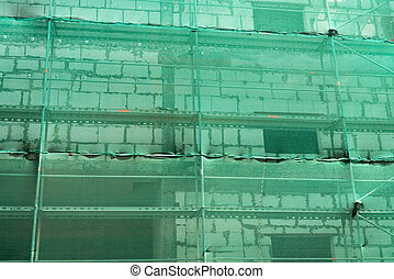 Construction scaffolding and green debris netting abstract backg