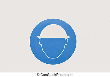 Construction sign of an isolated face male worker wearing a helmet