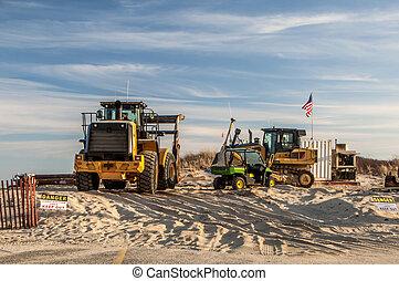 A sand replenishment construction site on the beach