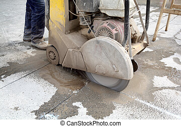 Construction site - Asphalt or concrete cutting with saw...
