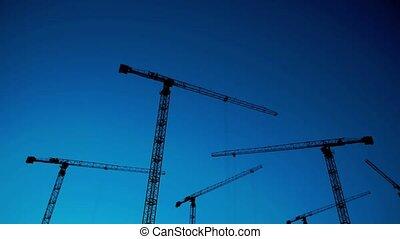Construction site at dusk, time lapse