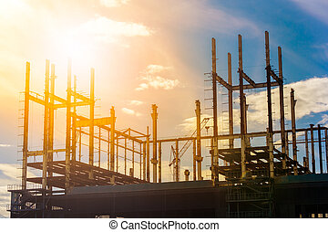 Construction site at sunrise - Building construction site at...