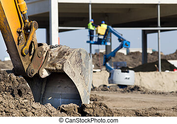 Construction site atmosphere - Close up of excavator bucket ...