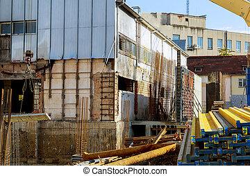 Construction site background. Hoisting cranes and new multi-storey buildings. construction work concrete Uzhhorod