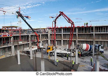 Construction Site - Construction site with cement mixer and...