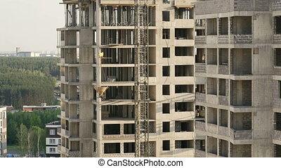 construction site. crane lifts the concrete tank