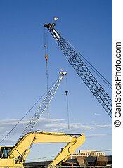 Construction Site Cranes and Backhoe