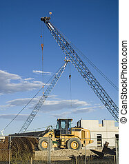 Construction Site Cranes and Bulldozer