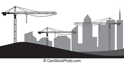 Construction site, cranes and silhouette of the city