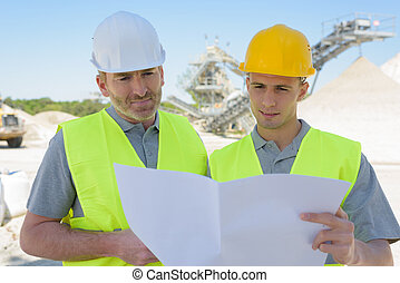 construction site engineers looking at plan