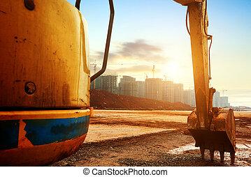 Construction site excavator - Big excavator on new...