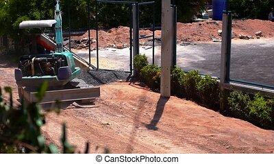 Construction Site Foundation with Excavator. Worker Operating on the Digger.