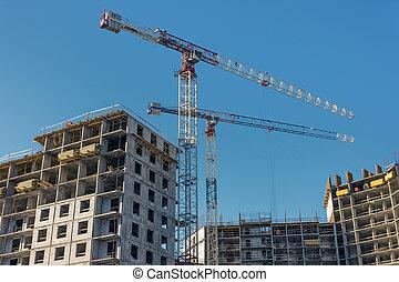 Construction site, high-rise multi-storey buildings under construction
