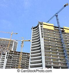 Construction site. High rise multi storey buildings under construction