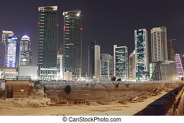 Construction site in Doha downtown at night. Qatar, Middle East