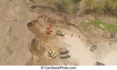 Construction site in the mountainside - excavator at...
