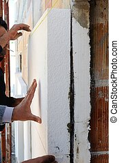 Installing external insulation. - Construction site - ...