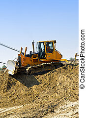 Construction site machines - Yellow bulldozer machines...