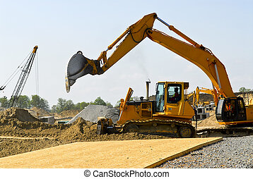 Construction site machines - Yellow bulldozer machines ...