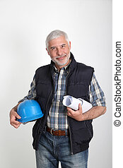 Construction site manager with security helmet