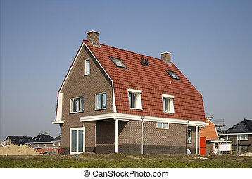 Construction site - New house on a construction site in...