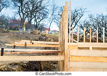 Construction site of new house, framing with wood and timber