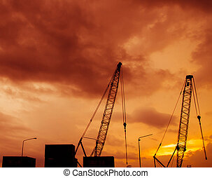 construction site silhouette on sunset time .