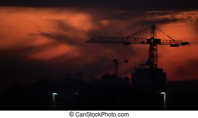 Construction site silhouettes on twilight
