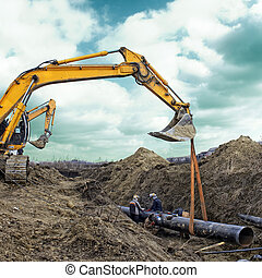 Construction site, excavator wearing metal pipe