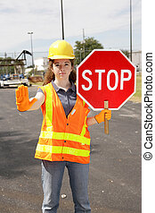 Construction Site Stop - A female construction worker...