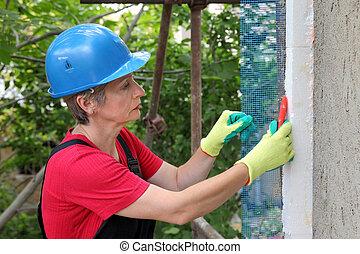Construction site, styrofoam insulation mesh cutting