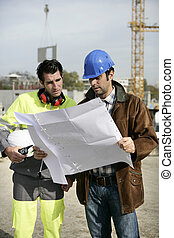 construction site supervisors looking at a blueprint