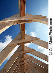 Construction site - View of blue sky through the wooden ...