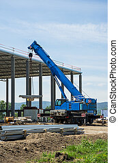 construction site with blue mobile crane