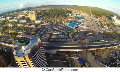 Construction site with crane and highway shot from UAV ...