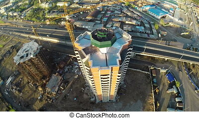 Construction site with crane and highway shot from UAV...