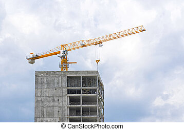 Construction site with crane over skyscraper building